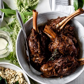 Balsamic & Caramelized Onion Braised American Lamb Shanks over White Bean & Winter Greens Risotto